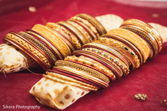 Maharani's bridal golden and red bangles.