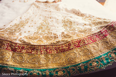 Stunning Indian bride's white, red, golden and green lengha.