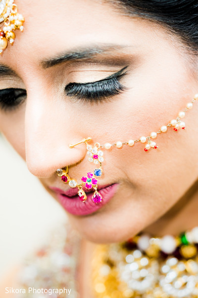 Marvelous Indian bride's nose earring.