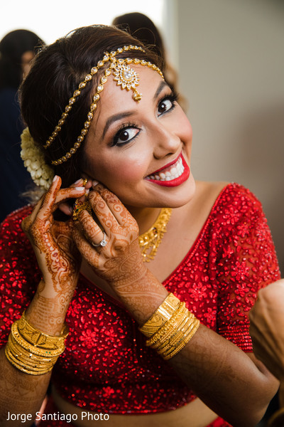 Stunning Indian bride getting her earrings on.