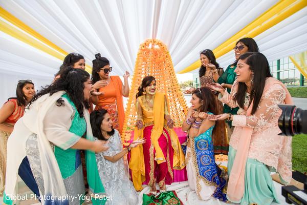 indian wedding gallery,outdoor photography,pre-wedding celebrations,indian bride,haldi ceremony