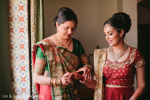 Indian bride putting her bangles on