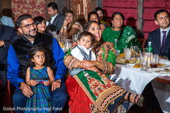 Family enjoying indian engagement party
