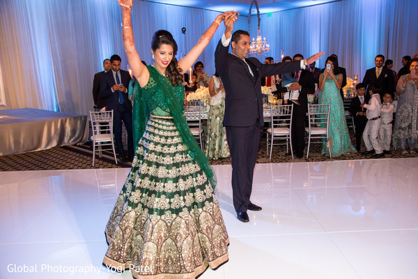 Joyful indian couple making their entrance