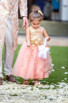 Flower girl throwing away petals