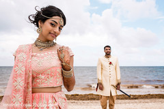Lovely indian bride and groom by the beach photo shoot