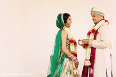 Indian couple following wedding traditions