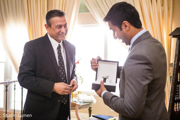 Indian groom opening wedding gift