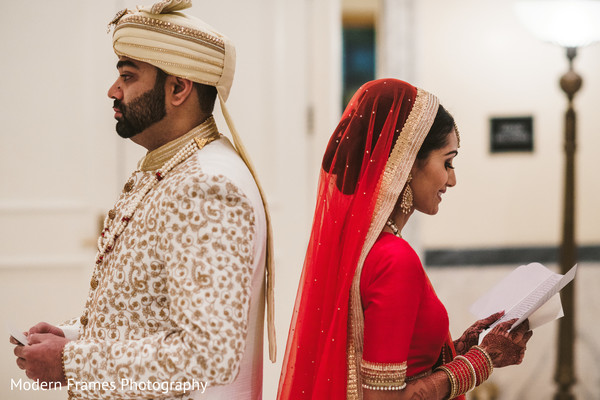 Indian bride and groom about to have their first look