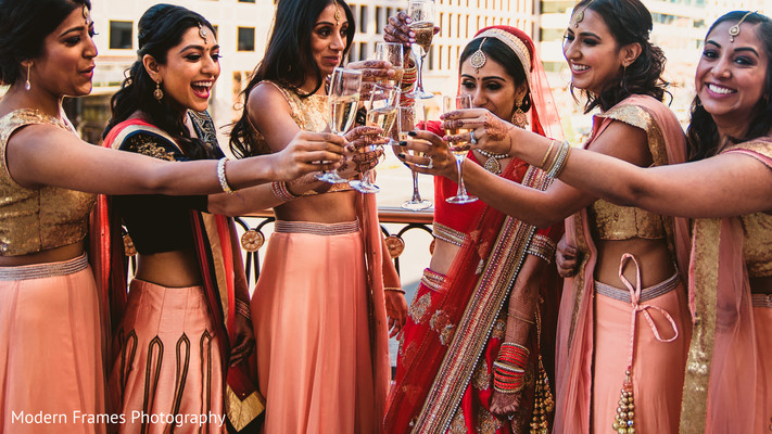 Indian bride toasting with her bridesmaids