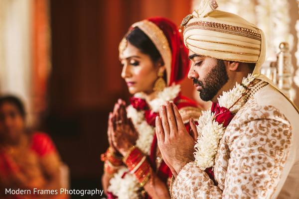 Lovely indian couple following wedding traditions