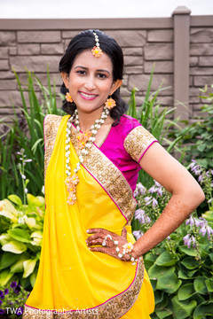See this lovely maharani in a yellow and pink sari