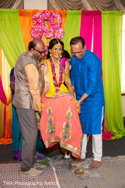 Indian bride being lifted during pithi