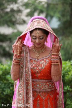 Beautiful indian bride posing for photo shoot