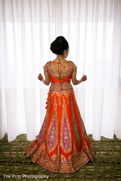 Indian bride looking out the window ready to get married