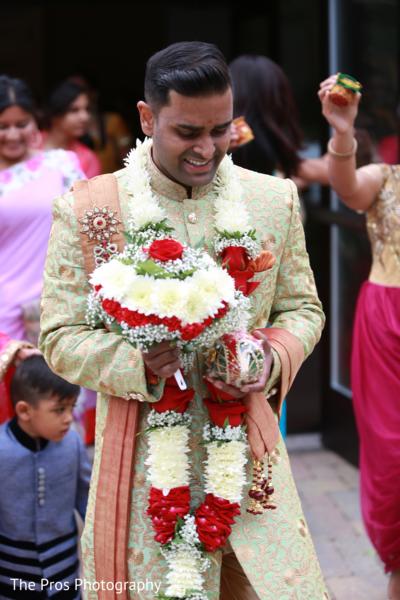 Indian groom's joyful entrance