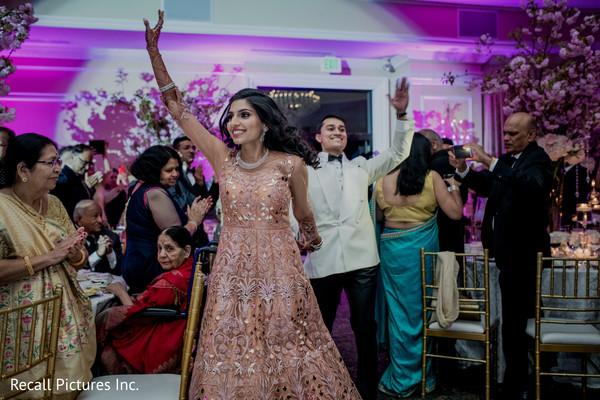 Gleeful indian newlyweds' entrance