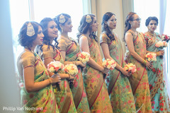Indian bridesmaids during wedding ceremony
