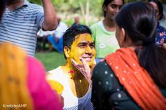 Indian groom being applied haldi paste