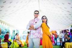 Indian couple posing during haldi