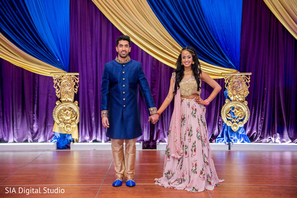 Elegant indian couple's sangeet oufit