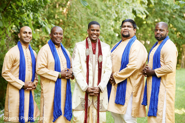 Handsome indian groom with groomsmen