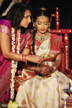 Lovely indian bride during wedding traditions