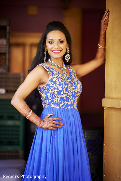 Indian bride in a fabulous blue and gold gown