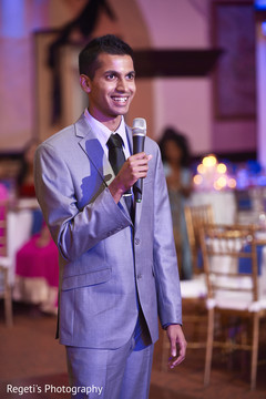 Indian wedding guest sharing some words