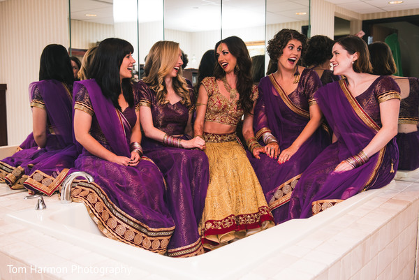 Indian bride having a great time with her bridal party