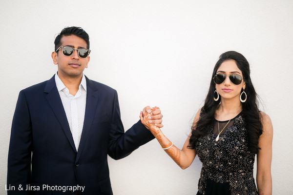 Elegant indian bride and groom posing for photoshoot