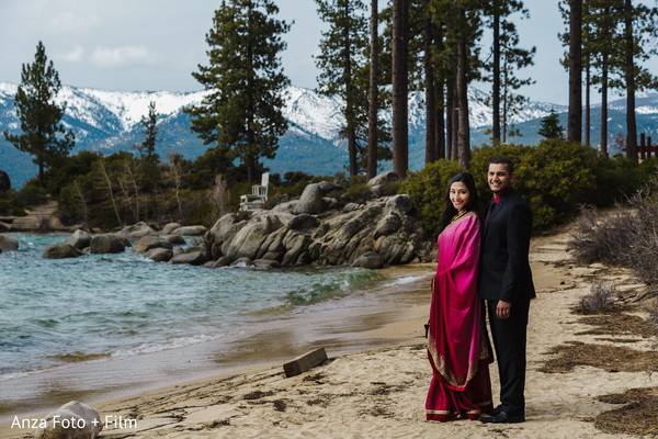 Indian bride and groom portrait by the beach