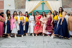 Indian bride with bridesmaids posing