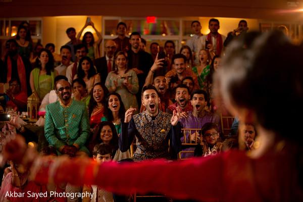 Indian couple having fun during their sangeet