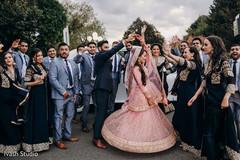 Indian bride twirling in her lengha
