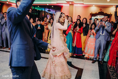 Indian bride and groom performing a choreography