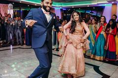 Indian couple joyfully dancing