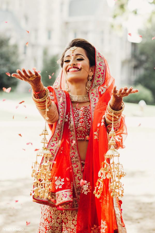 Indian bride throwing rose petals
