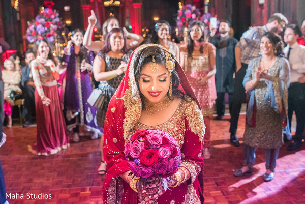 Indian bride  about to throw the bouquet