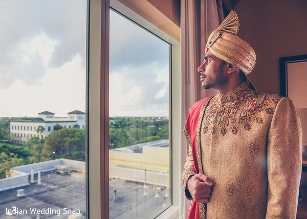 Indian groom looking out the window capture