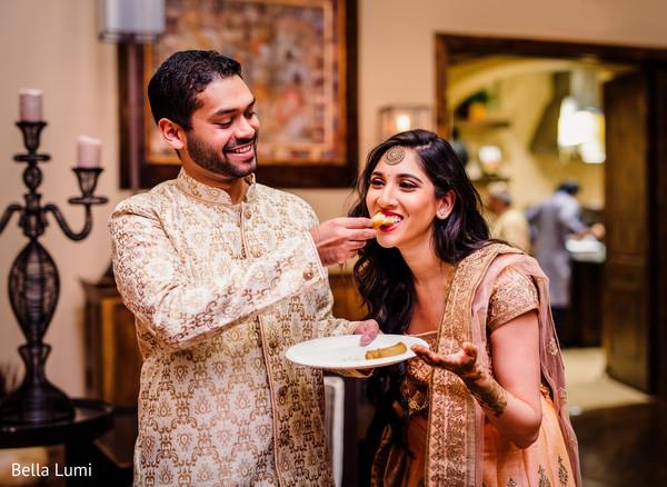 Indian bride tasting the food