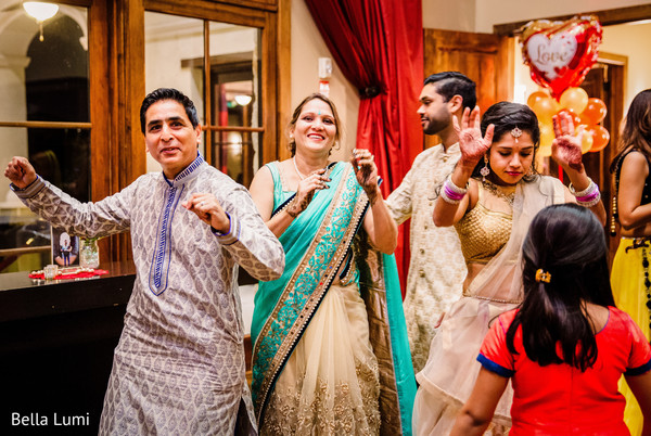Joyful indian guests dancing