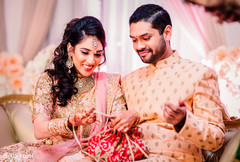 Indian couple receiving their engagement gifts