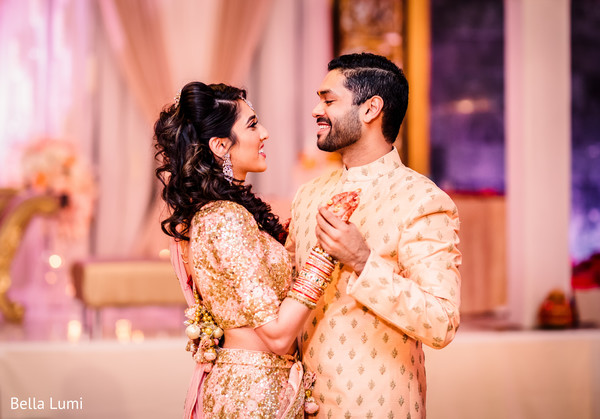 Indian couple dancing during their engagement party