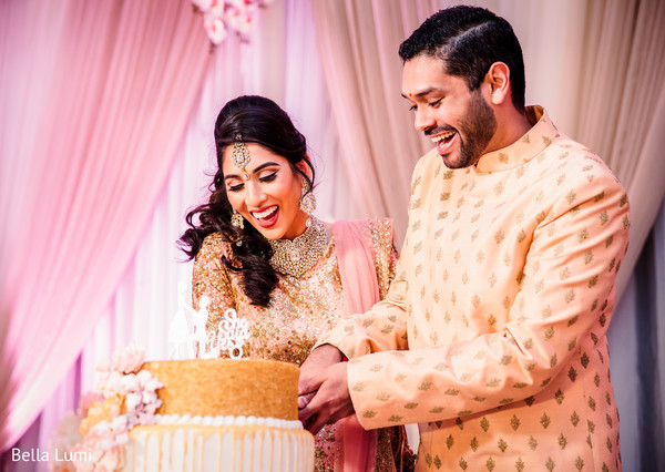 Indian couple cutting their engagement cake