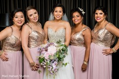 Lovely indian bride posing with bridesmaids