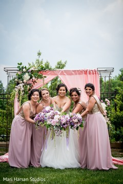Dazzling indian bride with bridesmaids capture