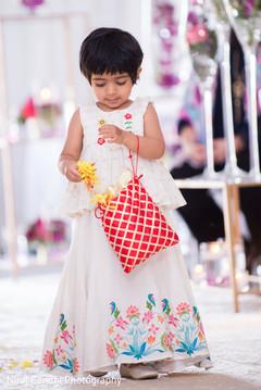 Lovely capture of Indian wedding flower girl.