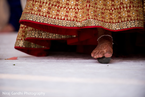 Indian bride rolling betel nut with toes.