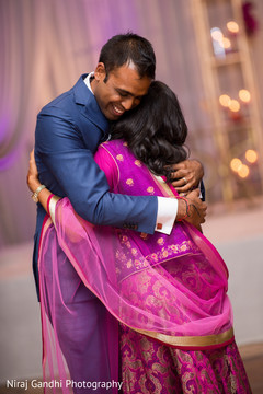 Special moment for Indian groom at wedding reception.